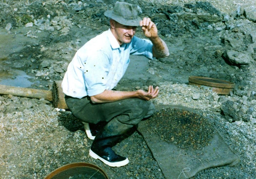 Rod Cook of Reddestone Sapphires working in the dry creek bed of Reddestone Creek approx 1967